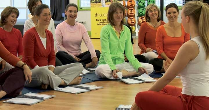 Students sit and learn about Dru Yoga