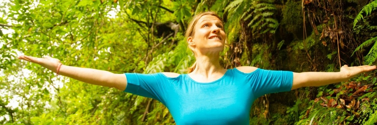 Evie Dru Yoga arm stretch forest ferns